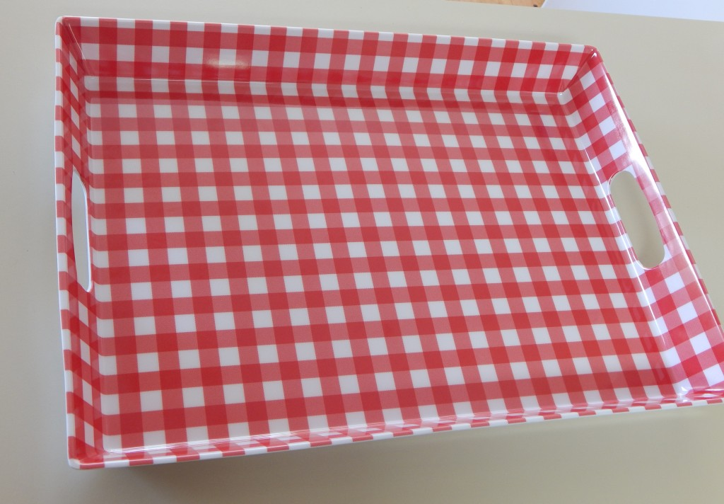 Plastic serving tray about 18x13x2 inches with hand-hold slots in each end.