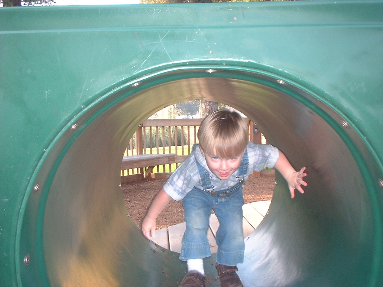 child playing on playground structure
